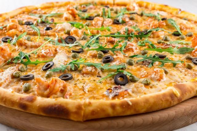 Dobre ciasto, mięso i ser to nie wszystko – poznaj dodatki, które wspaniale urozmaicają smak pizzy